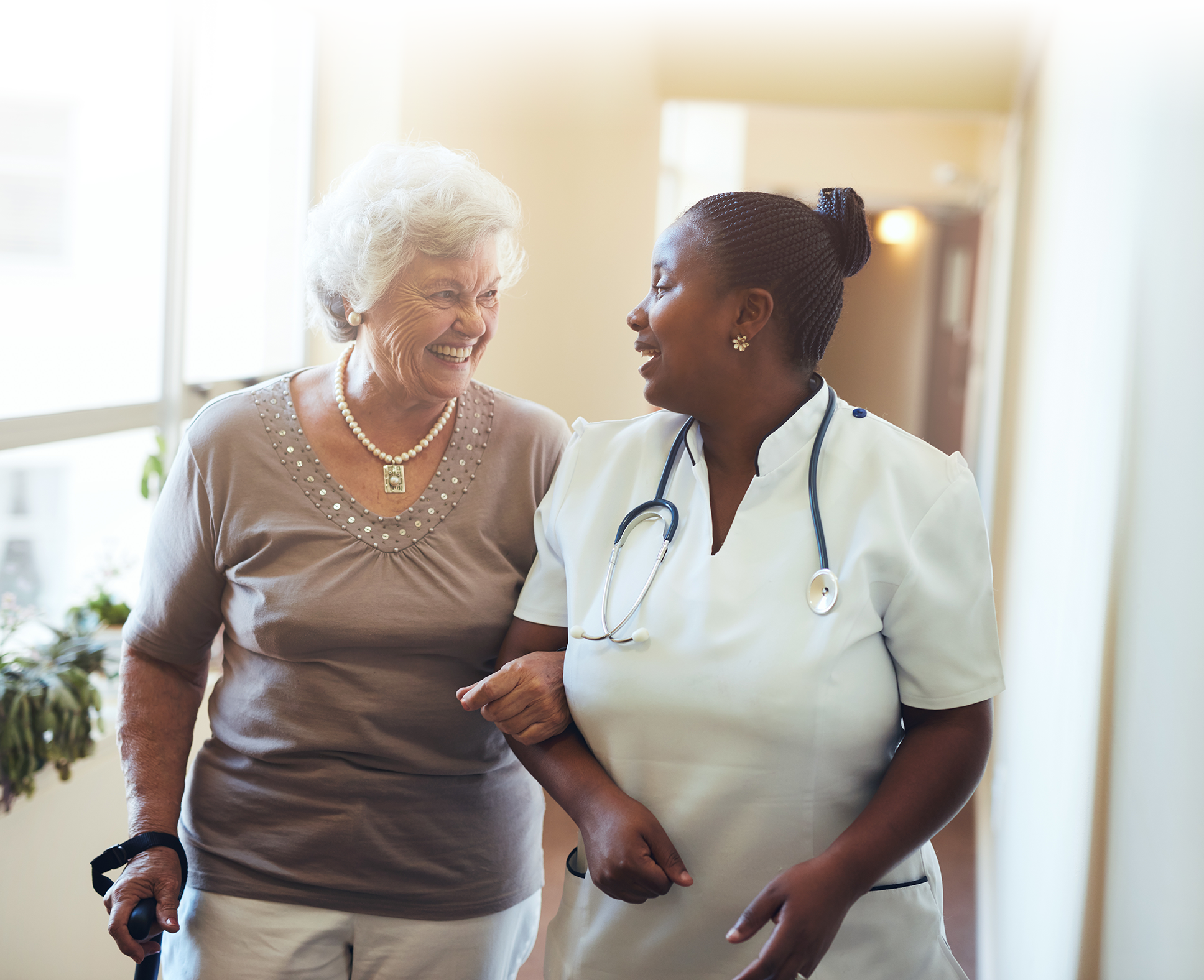 senior woman walking with nurse at discovery commons bradenton