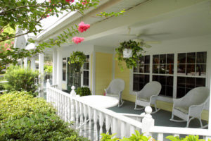 yellow porch as one of many senior living community amenities