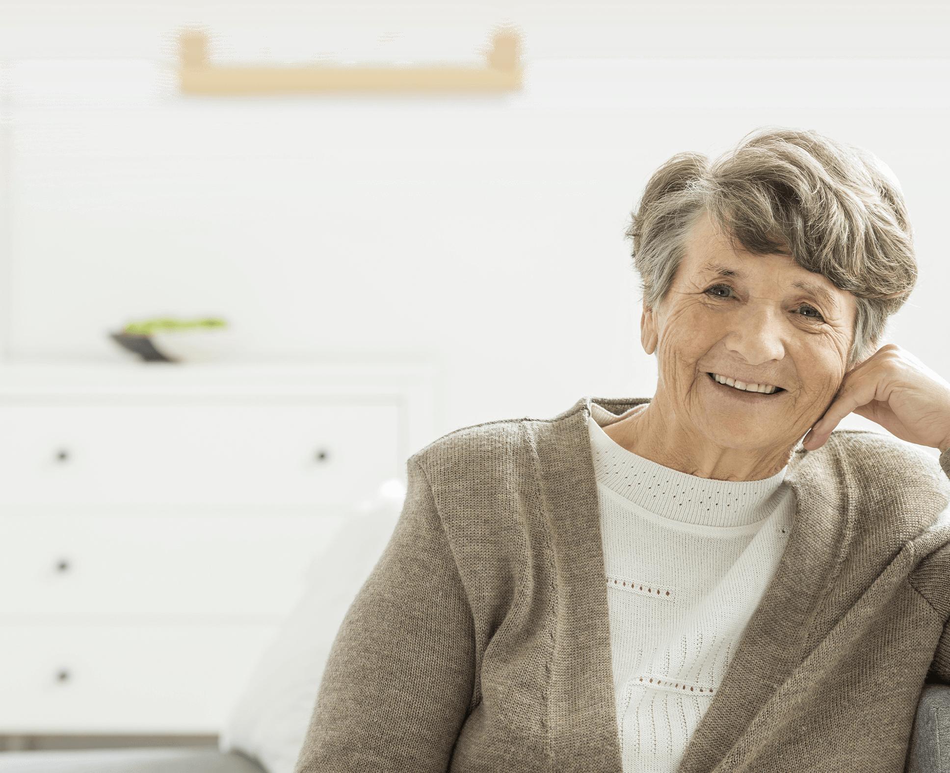 senior woman smiling at her residential senior living suite
