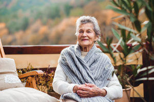woman sitting on the porch at Senior Respite Care Homes