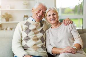 senior man and woman on a couch learning about Residential Senior Living Options