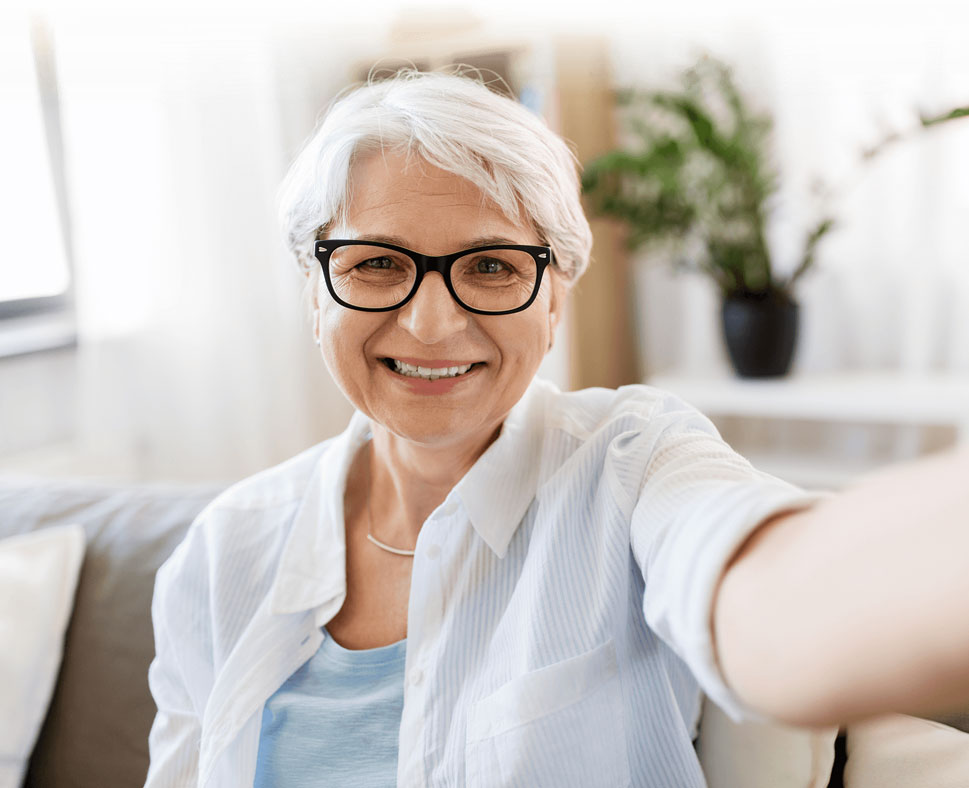 senior woman with glasses smiling