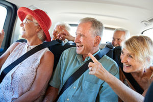 seniors in a van using Senior Living Transportation Services