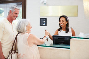 Senior Living Concierge Services desk with smiling seniors